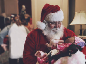 santa holding baby at St. Luke